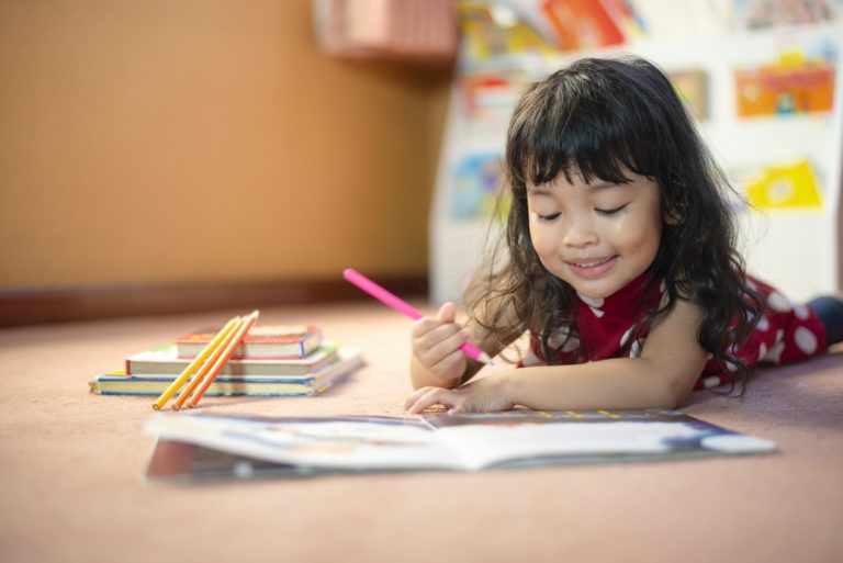 Child coloring a book