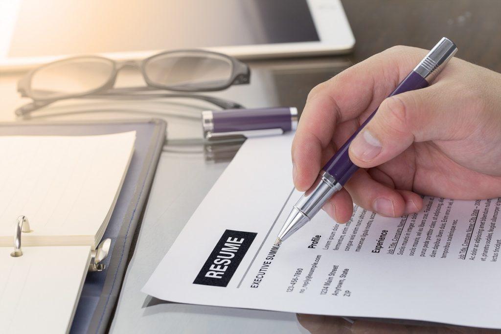 Job seeker reviewing his resume