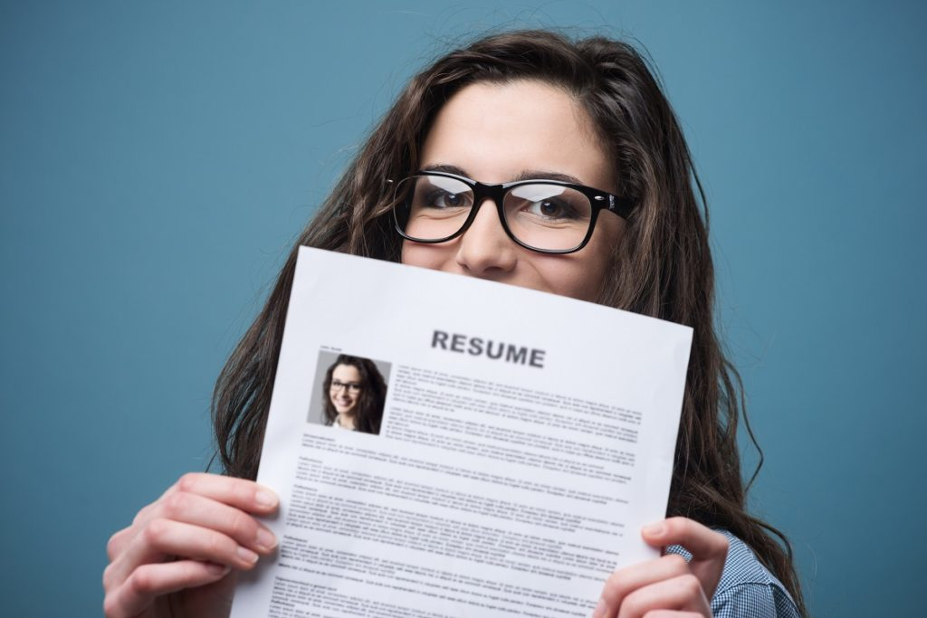 Young adult showing her resume