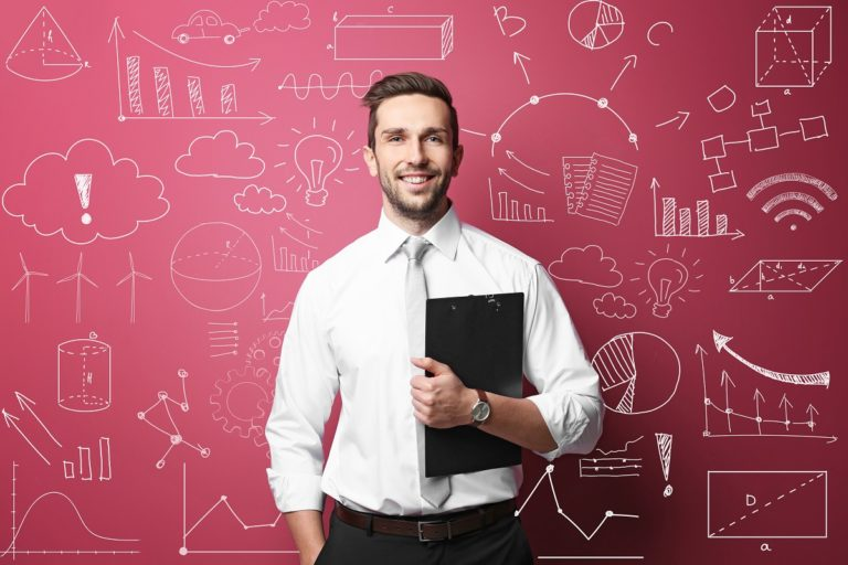Man in front of pink wallpaper