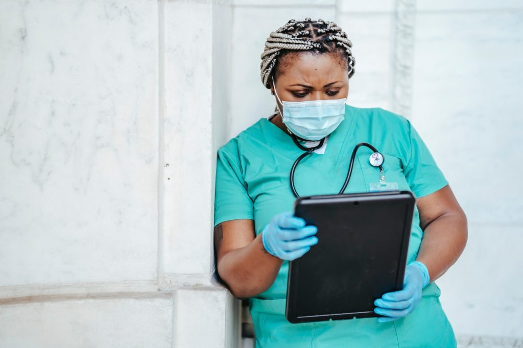 nurse using her iPad