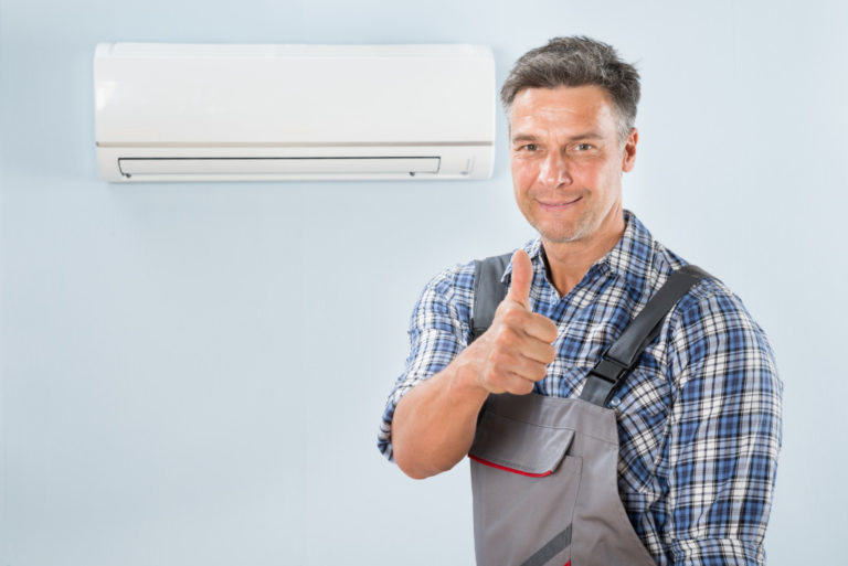 man cleaned an ac unit