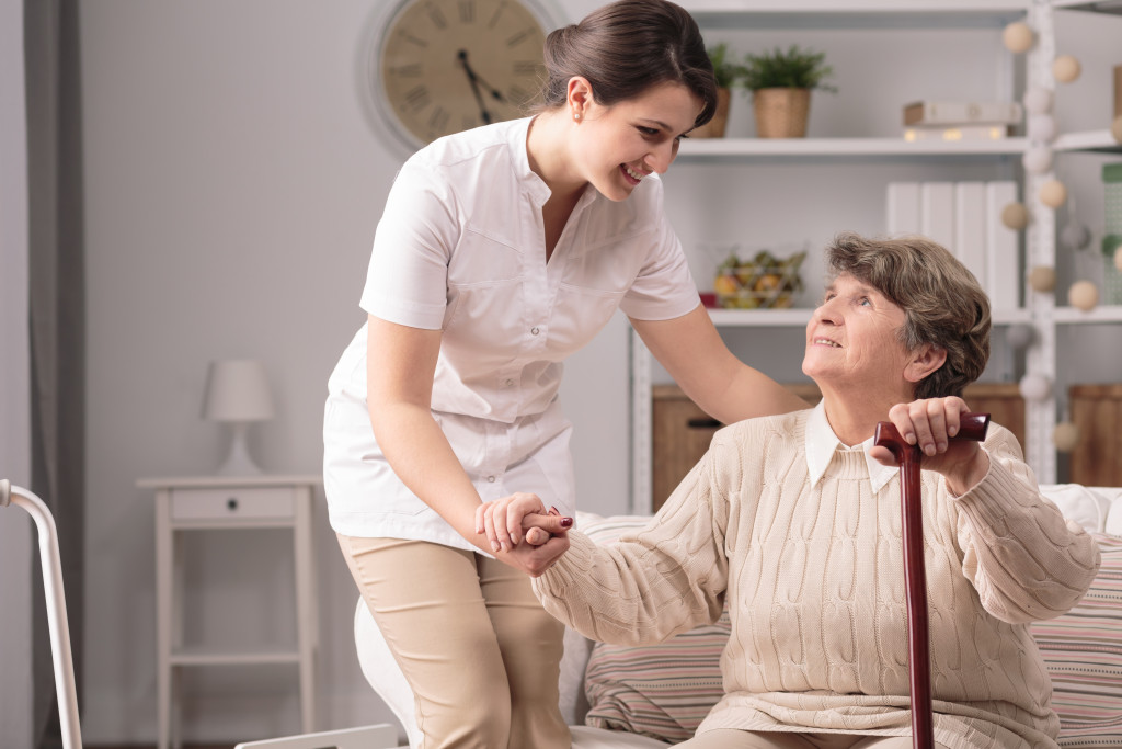 elderly woman being assisted